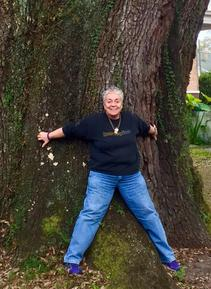 Elizabeth Jensen Forbell holding up the tree